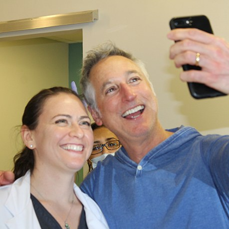 Cumming Georgia orthodontist and patient taking selfie together