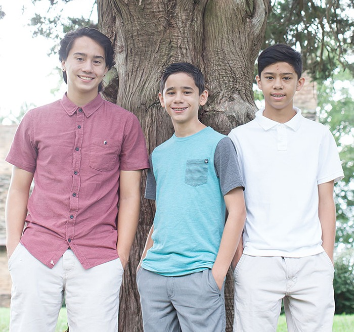 Three teen boys with braces and retainers