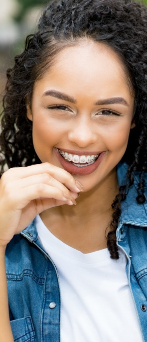 Young woman with traditional metal braces