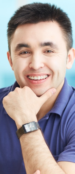 Man with ceramic braces