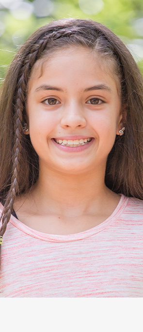 Young girl with InBrace braces smiling
