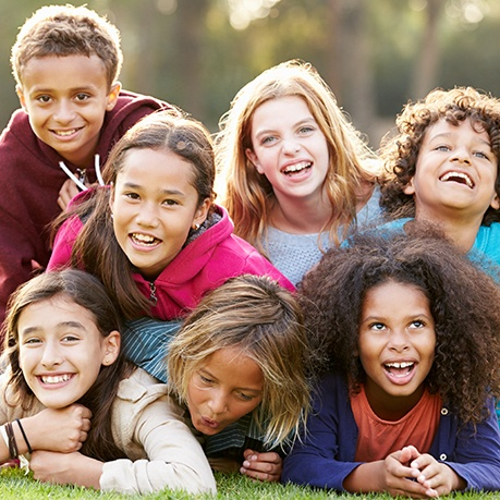 Group of kids smiling outdoors
