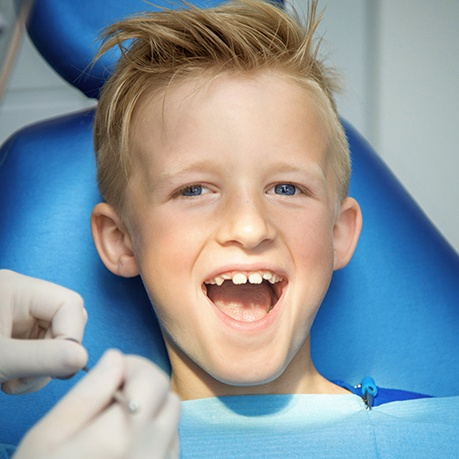 Young boy smiling during orthodontic appointment