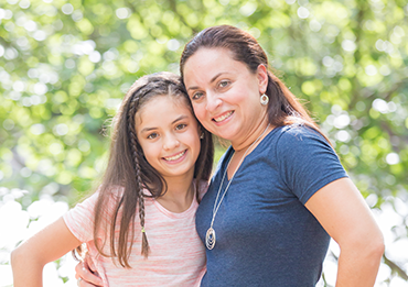 Mother smiling with her daughter who has InBrace orthodontics