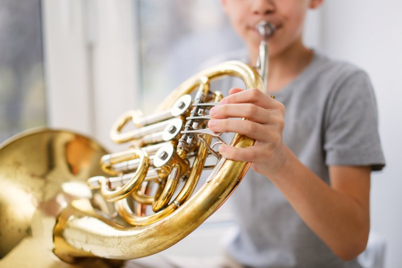 Playing French horn