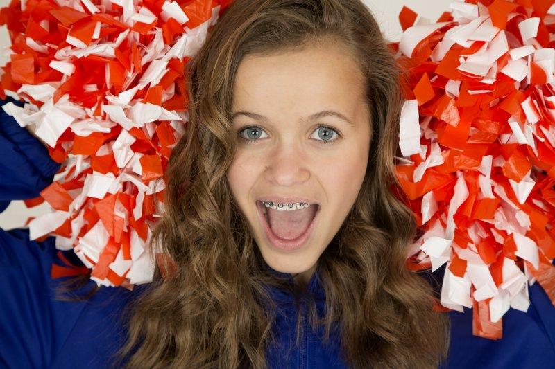 female cheerleader with braces